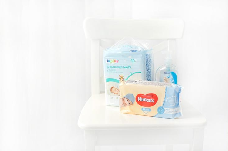 I use wet wipes with 99% water. I have an individual diaper pad for each baby.
